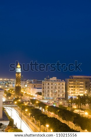 Clock Tower avenue Habib Bourguiba Ville Nouvelle Tunis Tunisia Africa  with car  night light streaks - stock photo