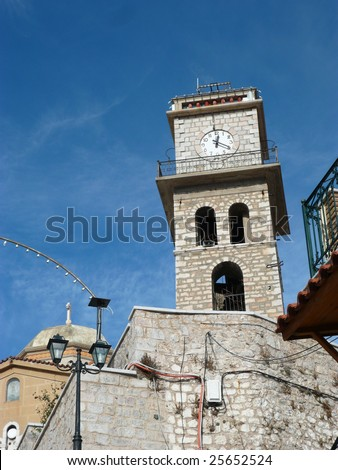 clock tower next to a church in the mountains in (Arachova) greece
