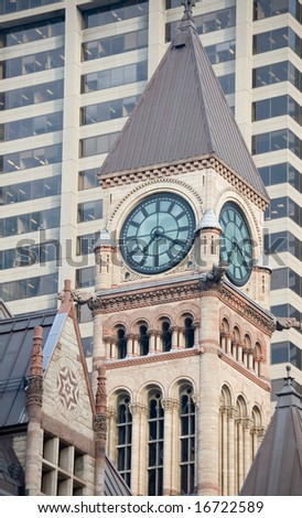 Clock tower of Old Toronto City Hall against modern building