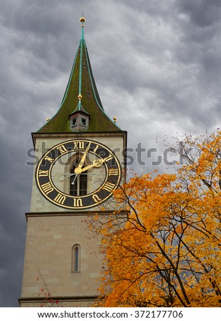 Clock tower of St. Peter's Church, Zurich, Switzerland.The steeple's clock face has a diameter of 8.7 m, the largest church clock face in Europe. - stock photo