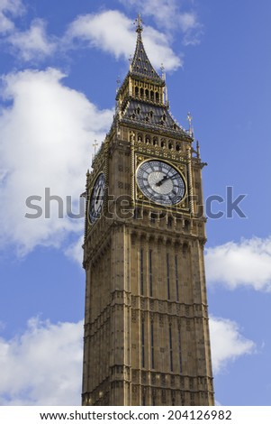 Clock Tower of the Houses of Parliament in London - England - stock photo