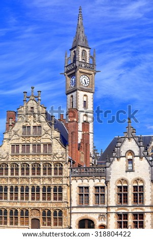 Clock tower of the Old Post Office surrounded by historical buildings in Ghent, Belgium