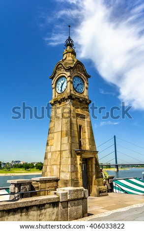 Clock tower on the riverside of Dusseldorf, Germany - stock photo