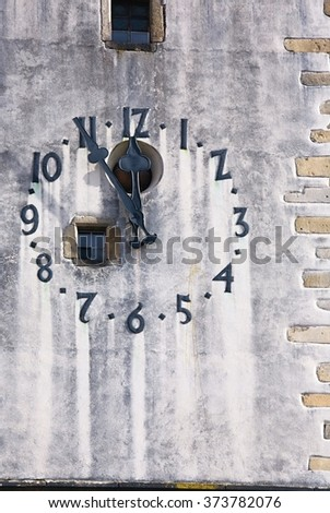 clock tower showing five minutes to twelve - stock photo