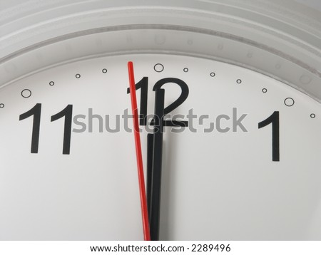 Clock with a minute and hour hands on 12 and a second hand on 59 - deadline symbol - stock photo