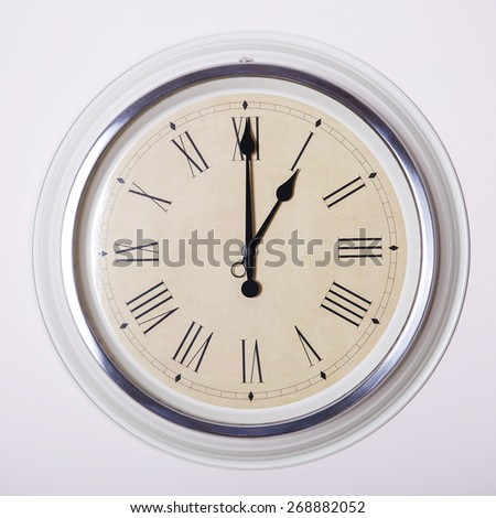 clock with Roman numerals at 1 o'clock - stock photo