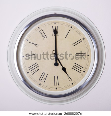 clock with Roman numerals at 5 o'clock - stock photo