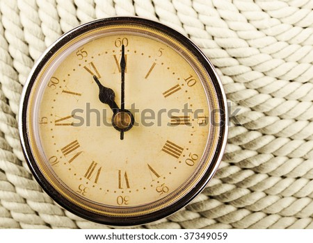 Clock with Roman numerals on cord background. 11 - stock photo