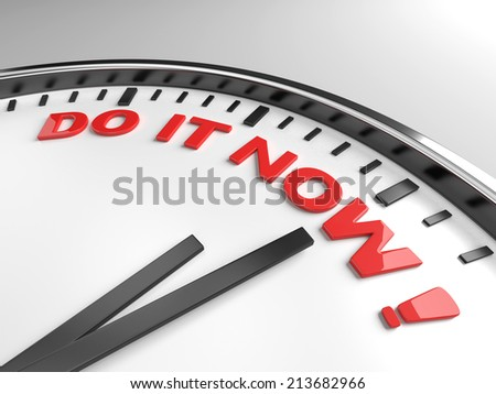 Clock with words do it now on its face - stock photo