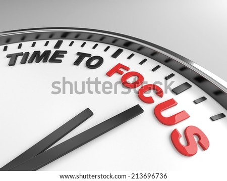 Clock with words time to focus on its face - stock photo