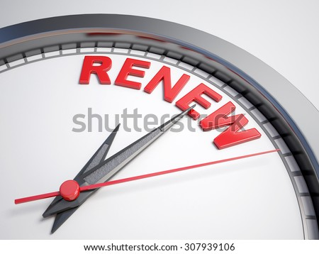 Clock with words time to renew on its face - stock photo