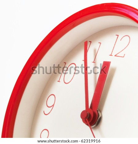Clocks showing five minutes before twelve to symbolize possible upcoming danger, threat or even doom. - stock photo