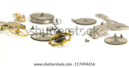 Clockwork details on a white paper - stock photo