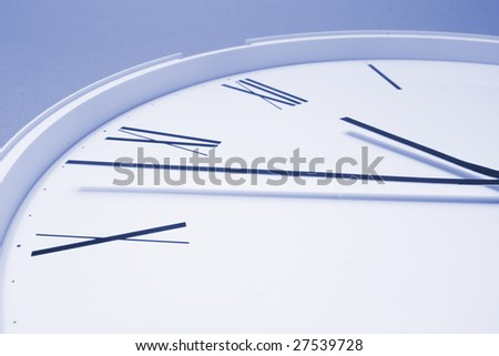Cloe Up of Clock Face in Blue Tone - stock photo