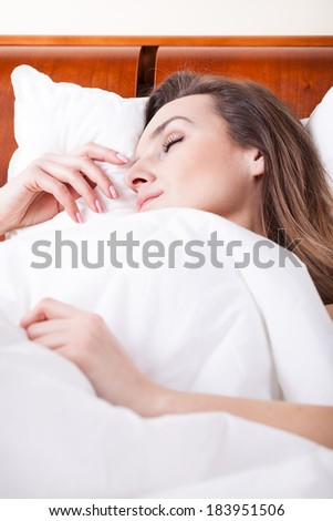 Cloesup of a woman sleeping in bed - stock photo