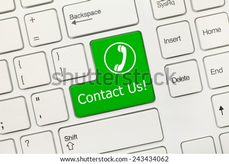Clos- up view on white conceptual keyboard - Contact Us (green key with handset) - stock photo