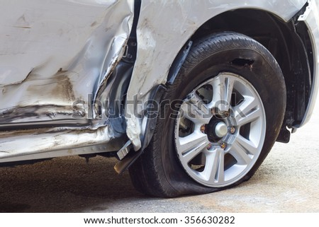 Close demolished down the side of a car which collided with another vehicle accident, plying dangerous. - stock photo