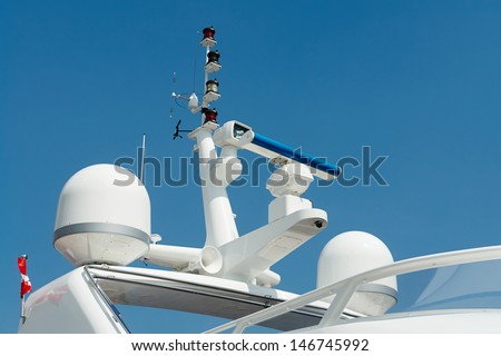 Close details of radar  navigation system and communication tower on a fancy motor yacht                             - stock photo
