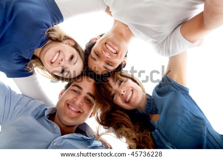 Close group of friends hugging isolated over a white background