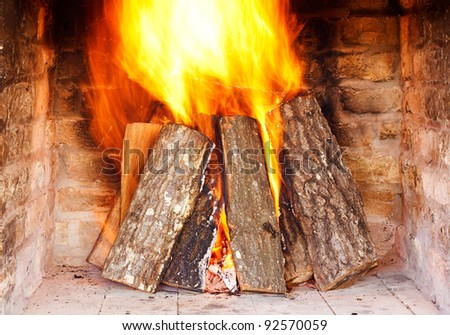Close image of fire in the fireplace