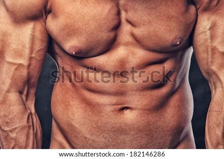 CLose image of muscle man posing - stock photo