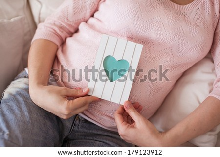 Close image of pregnant woman - stock photo