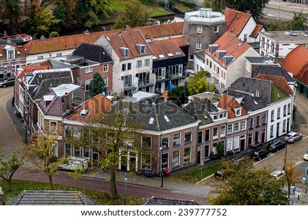 Close Knit Community in Europe with Center Garden Surrounded by Community Houses - stock photo