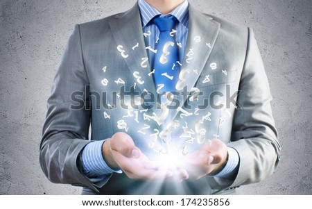 Close of businessman holding numerals in palms - stock photo