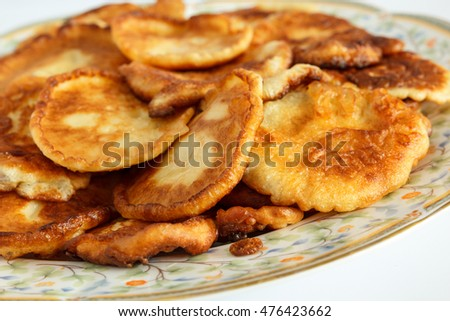 "Close of homemade small pancakes. Traditional bulgarian pancake-like breakfast ""buhti"". Selective focus and shallow depth of field"