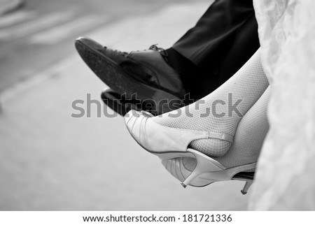 Close of of feet of a bride and her bridesmaids  - stock photo