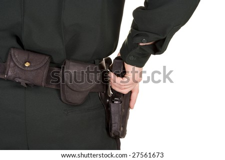 Close of of policeman's hand on his gun. - stock photo