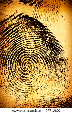 Close of thumb print  on old paper - stock photo