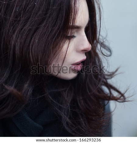 Close portrait of a beautiful sexy girl in the wind - stock photo