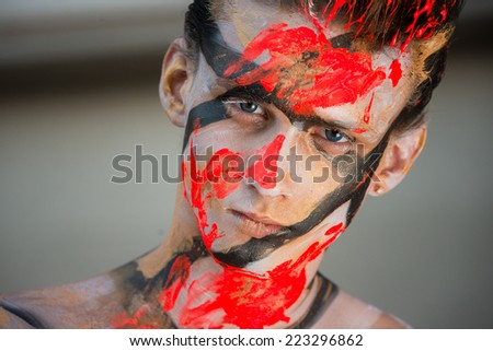 Close portrait of a young sexy guy in makeup.