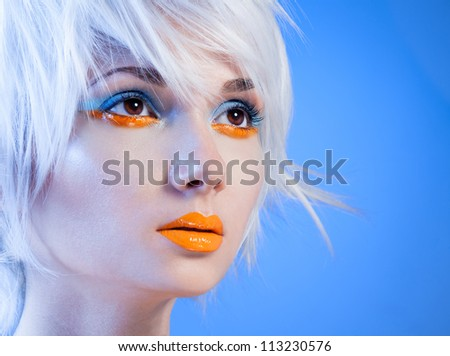 close portrait of attractive blonde girl with sensual orange lips - stock photo