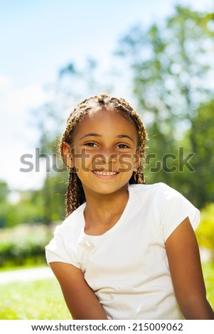 Close portrait of black girl in the park - stock photo