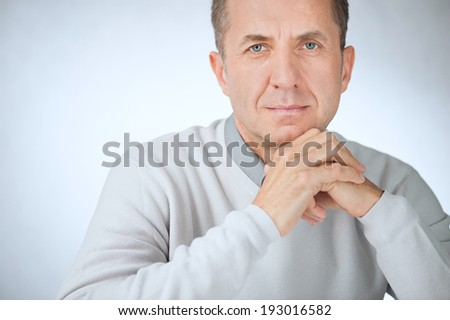 Close portrait of confident middle aged businessman with hands - stock photo