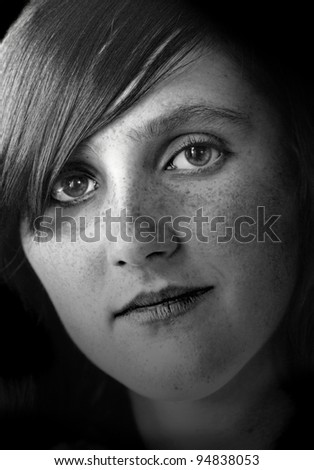 Close portrait of young woman with freckles - stock photo