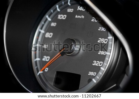Close proximity shot of a speedometer of a sports car