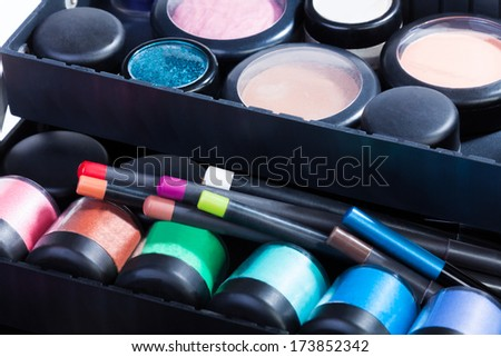 Close shoot of makeup case containing with jars tubes, lipstick mascara, powder and the rest - stock photo