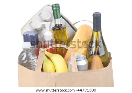 Close shot of a Brown Kraft Paper Bag with Handles full of assorted groceries isolated over white Horizontal format - stock photo