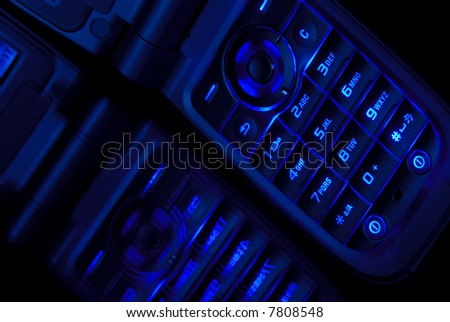 Close Shot of Cell Phone In Deep Blue On Reflective Surface