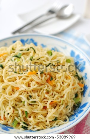 Close shot of huge serving of Chinese vegetarian noodles cooked with healthy vegetables. Suitable for concepts such as diet and slimming, healthy lifestyle, and food and beverage. - stock photo