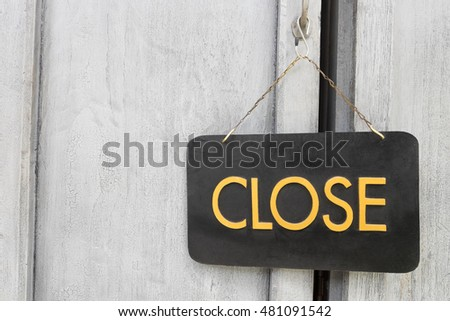 Close sign on old wood door.