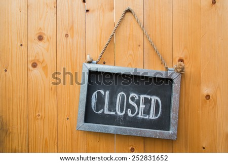 Close Sign On Wood Door - stock photo
