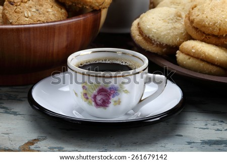Close uo on a cup of coffe in the breakfast table - stock photo