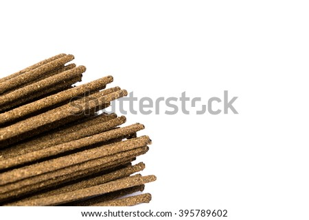 Close-up a bunch of incense sticks isolated on white. Incense use in religious ritual popular in Vietnam.Its burned to intend as a sacrificial offering to various deity or to serve as an aid in prayer - stock photo