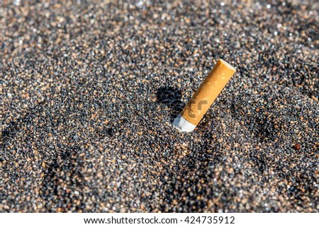 Close up a cigarette butt in ash background, quitting smoking concept. - stock photo