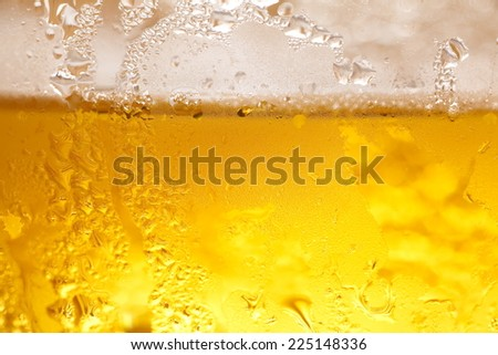 Close - up a glass of cold beer - stock photo