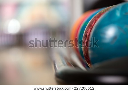 Close-up a group of colored bowling balls in the club. - stock photo